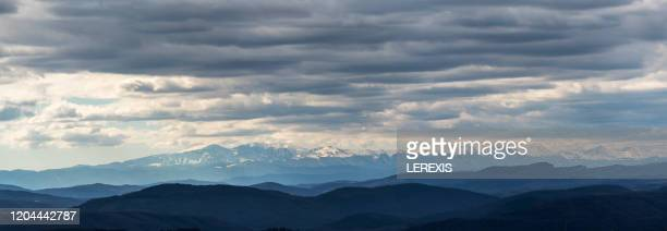 panoramic view of the snowy mountains - lerexis stock pictures, royalty-free photos & images