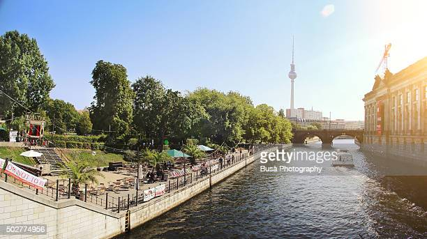 Panoramic view of the Spree river with the Monbijoupark on the left, the Museums Island with the Bodemuseum on the right, and the  Fernsehtrum (TV Tower) in the background. Berlin, Germany