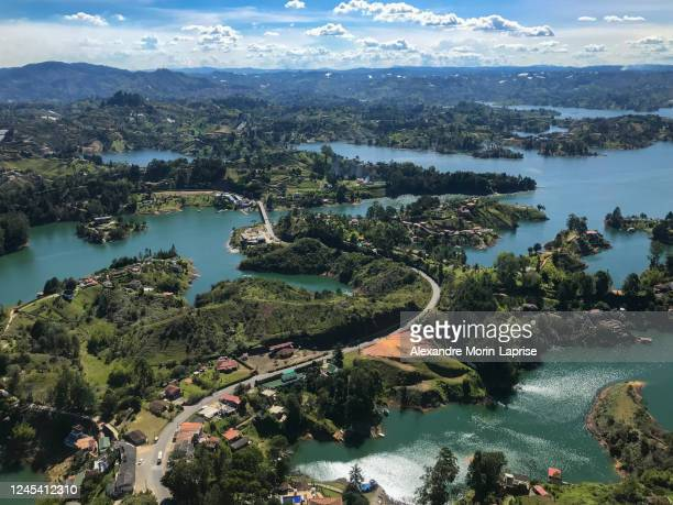 panoramic view of the stone, the guatapé peñol and the slopes of the small hills that surround it that look like islands. - guatapé stock pictures, royalty-free photos & images