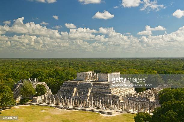'A panoramic view of the Temple of the Warriors out of jungle at Chichen-Itza. A Mayan ruin, in the Yucatan Peninsula, Mexico'