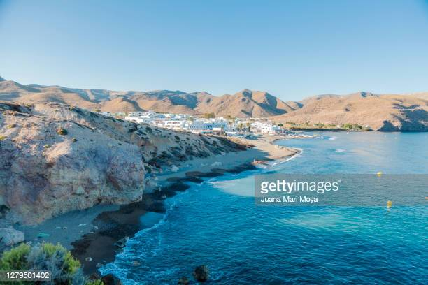 """panoramic view of the town of """"las negras"""", cabo de gata, almería, andalusia, spain - andalucia stock pictures, royalty-free photos & images"""