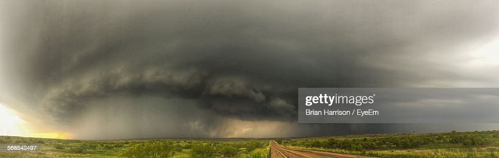 Panoramic View Of Thunderstorms Over Landscape : Stock Photo