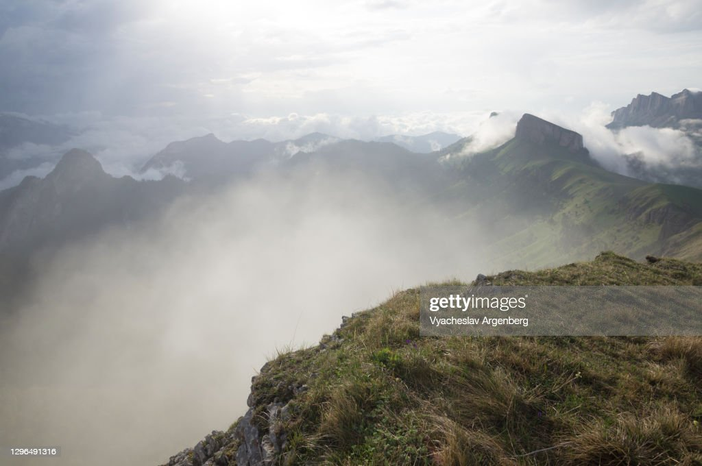 Panoramic view of Tkhach mountains in clouds, Caucasus : Stock Photo