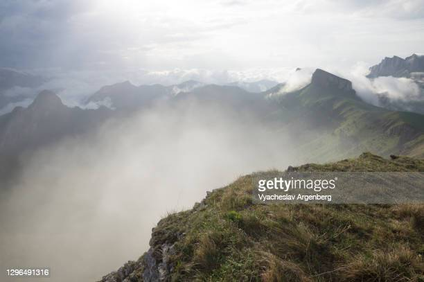 panoramic view of tkhach mountains in clouds, caucasus - argenberg stock pictures, royalty-free photos & images