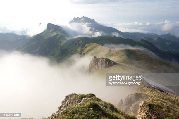 panoramic view of tkhach mountains in clouds, mountain landscape, caucasus - argenberg stock pictures, royalty-free photos & images
