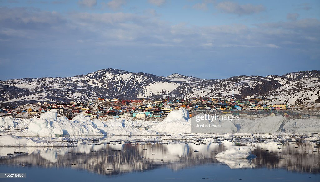 Panoramic view of town with icebergs and mountains : Stock Photo