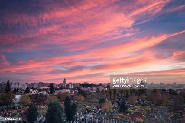 panoramic view of townscape against sky at sunset - bucharest stock pictures, royalty-free photos & images