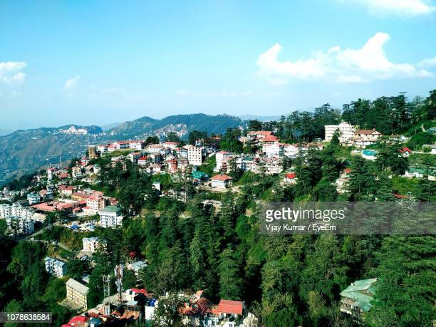 panoramic view of townscape against sky - shimla stock pictures, royalty-free photos & images