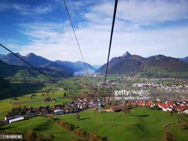 panoramic view of townscape against sky - schwyz stock pictures, royalty-free photos & images