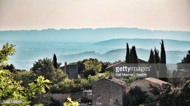 panoramic view of trees and buildings against sky - provence alpes cote d'azur stock pictures, royalty-free photos & images