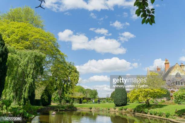 panoramic view of trees and buildings against sky - northamptonshire stock pictures, royalty-free photos & images
