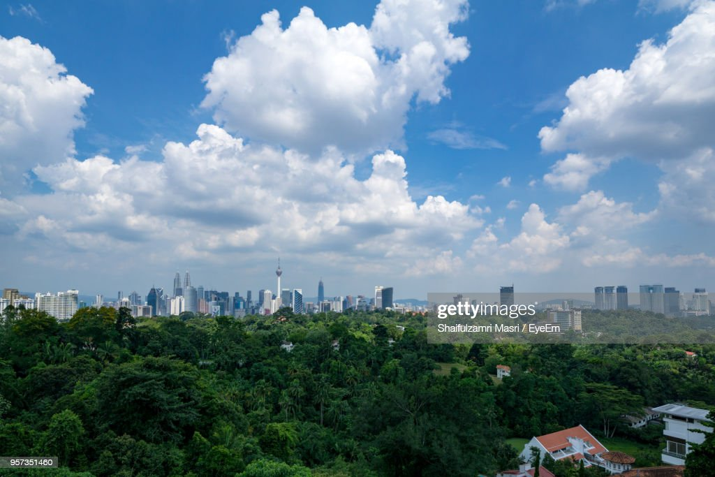 Panoramic View Of Trees And Buildings Against Sky : Stock Photo