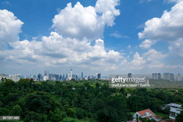 Panoramic View Of Trees And Buildings Against Sky