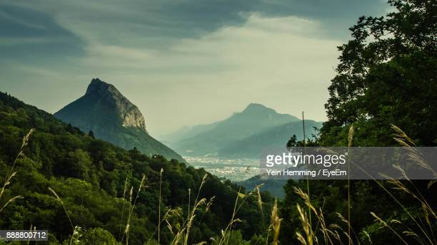 panoramic view of trees and mountains against sky - grenoble stock pictures, royalty-free photos & images