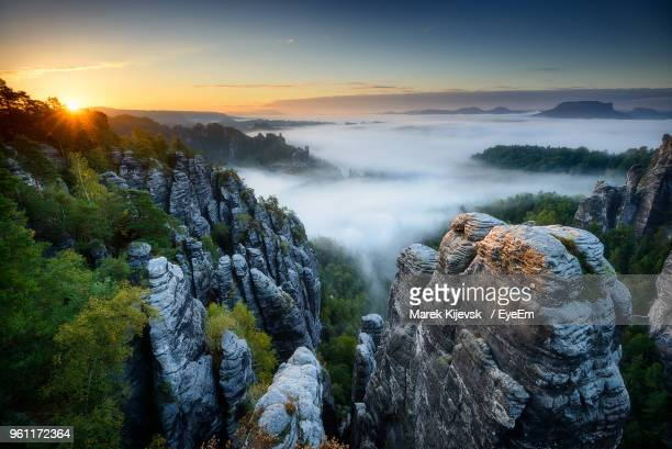 panoramic view of trees and rocks against sky during sunset - saxony stock pictures, royalty-free photos & images