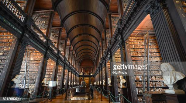 A panoramic view of Trinity College's Long Room Four early Christian manuscripts dating back to the Dark Ages were unveiled at Trinity College today...