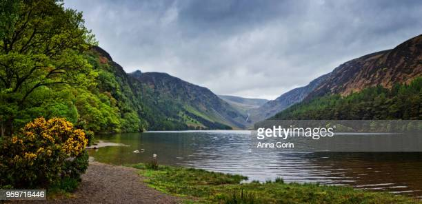 Panoramic view of Upper Lake in Wicklow Mountains National Park by Glendalough, stormy spring skies