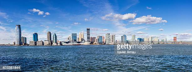 panoramic view of urban skyline of newport by river - jersey city stock pictures, royalty-free photos & images
