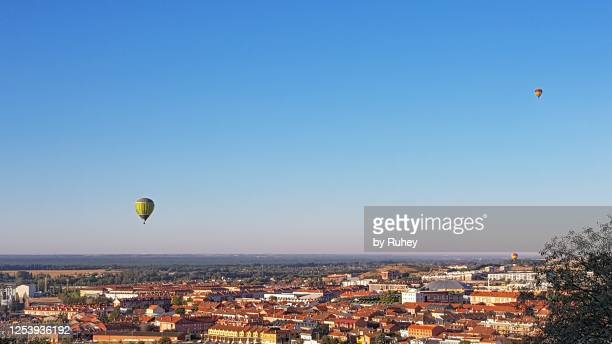 panoramic view of valladolid with two hot air balloons in the sky - valladolid spanish city stock pictures, royalty-free photos & images