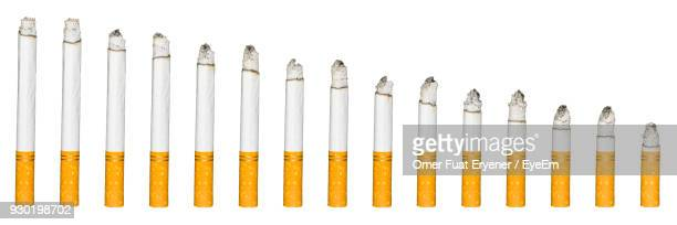panoramic view of various cigarettes over white - cigarette stock pictures, royalty-free photos & images