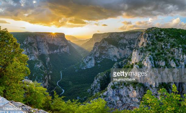 panoramic view of vikos canyon at sunset - epirus greece stock pictures, royalty-free photos & images