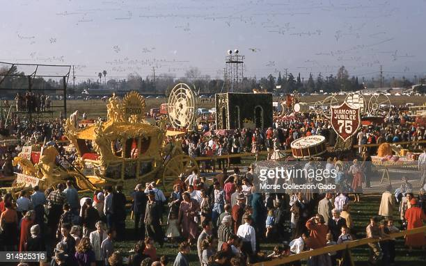 Panoramic view of visitors admiring floats displayed at the public showcase following the 1956 Tournament of Roses Parade in Pasadena California 1956...