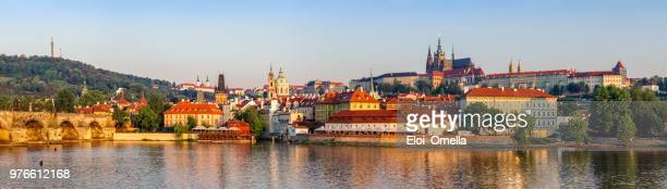 panoramic view of vltava river, mala strana distric and prague castle in the morning - charles bridge stock photos and pictures