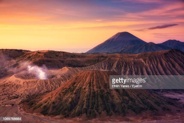 panoramic view of volcanic crater against sky during sunset - bromo tengger semeru national park stock pictures, royalty-free photos & images