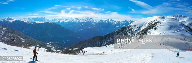 panoramic view of well prepared ski track in alpine ski resort. - downhill skiing stock pictures, royalty-free photos & images