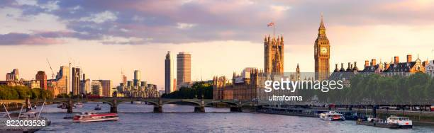 panoramic view of westminster bridge and westminster palace with big ben at sunset - whitehall london stock photos and pictures