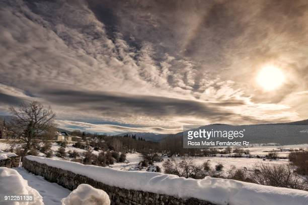 panoramic view of winter rural scene on sunny day with dramatic sky. - segovia stock pictures, royalty-free photos & images