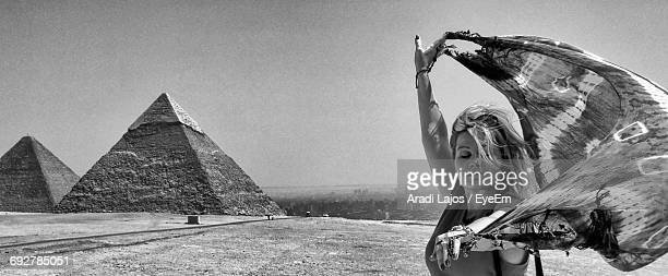 Panoramic View Of Woman Holding Sarong Against Pyramid Of Khafre