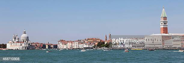 Panoramic view on Basilica di Santa Maria della Salute St Mark's Campanile and Doge's Palace on August 15 2013 in Venice Italy
