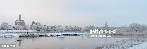 panoramic view on kampen and river ijssel in winter - sjoerd van der wal stock pictures, royalty-free photos & images