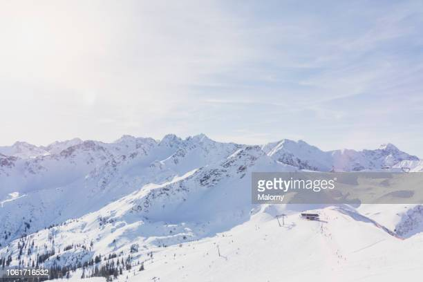 panoramic view on snow-capped mountains. - coberto de neve - fotografias e filmes do acervo