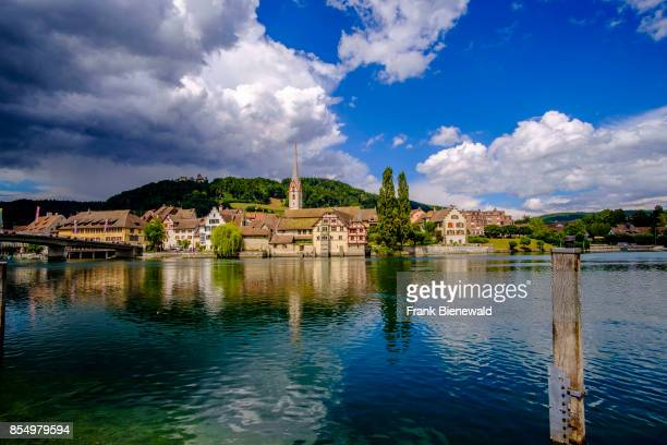 RHEIN SCHAFFHAUSEN SWITZERLAND A panoramic view on the small town across the river Rhine dark thunderstorm clouds above