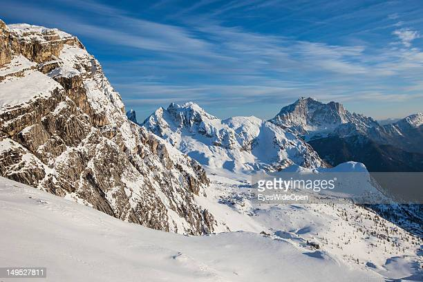 Panoramic view on the snowy mountains around the alpine mountain hut Rifugio Averau at the famous rocks Cinque Torri in the Dolomite Alps on March 9...