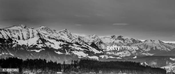 Panoramic view on the Vanil mountains, in the Gruyere region of Switzerland in Winter - Left to right:  Dent de Brenleire (2353m), Dent de Folliéran (2340m), Vanil Noir (2388,9m), Vanil carré (2197m), View from the City of Bulle, Fribourg, Switzerland