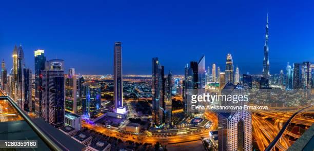 panoramic view over dubai at dusk, uae - burj khalifa stock pictures, royalty-free photos & images