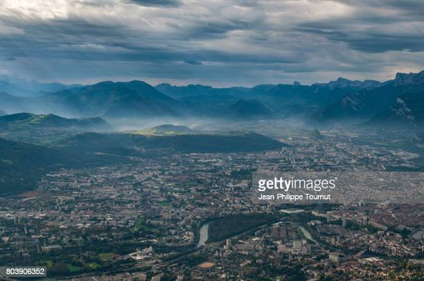 panoramic view over grenoble and the alps, france - grenoble stock pictures, royalty-free photos & images