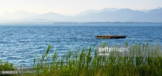 panoramic view over lake chiemsee with swimming platform, bavarian alps in the distance, chiemgau, upper bavaria, germany - diving platform stock pictures, royalty-free photos & images