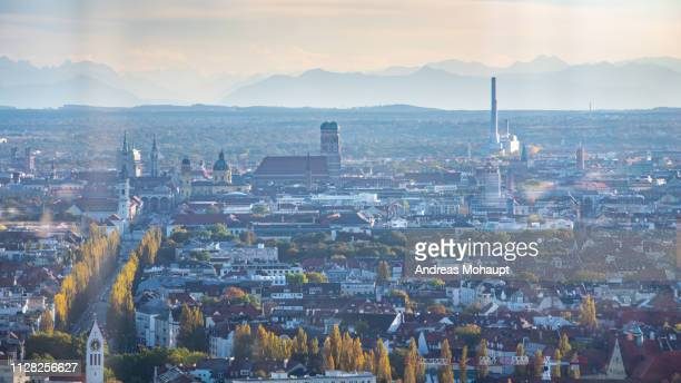 panoramic view over munich to the alps - städtische straße stock pictures, royalty-free photos & images