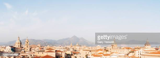 panoramic view over the city of palermo at sunrise - シチリア パレルモ市 ストックフォトと画像