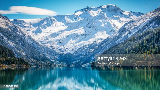 panoramic view over the gepatsch reservoir to the weißseespitze (kaunertal glacier) - beschaulichkeit stock pictures, royalty-free photos & images
