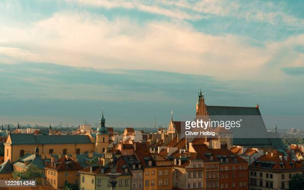 panoramic view over the old town of the polish capital in warsaw. beside many historical residential buildings, there are several churches and the sigismund column in the foreground. - catholicism stock pictures, royalty-free photos & images