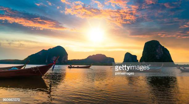 panoramic view shot tropical beach sea with long tail boat in south thailand - southeast stock pictures, royalty-free photos & images