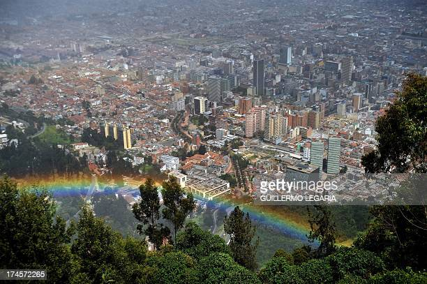 Panoramic view taken from the Cerro de Monserrate of a rainbow with city of Bogota in the background in Colombia on July 27 2013 AFP PHOTO/Guillermo...