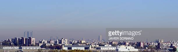 A panoramic view taken on November 13 2015 shows the pollution covering the sky of Madrid Madrid City Council took on November 13 2015 measures...