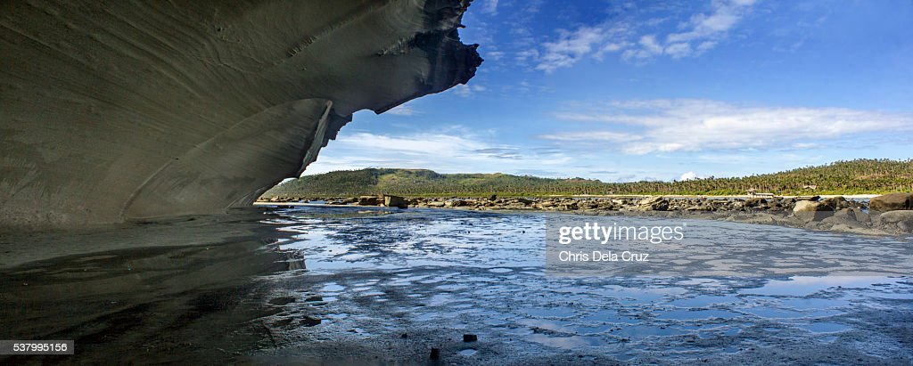 Panoramic view with enclosed rock cave on foreground : Stock Photo