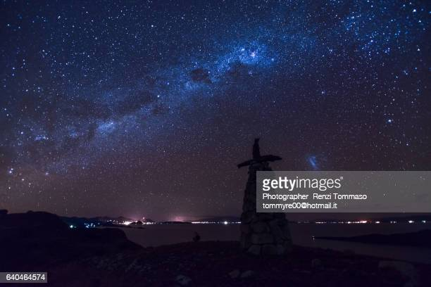 panoramic view with pachamama monumet and milkyway on isla del sol , titicaca lake - inca stock pictures, royalty-free photos & images